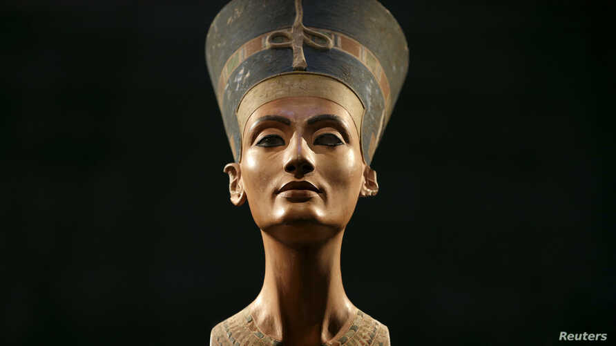 FILE - The Nefertiti bust is pictured during a press preview of the exhibition 'In The Light Of Amarna' at the Neues Museum in Berlin, Germany, due to the 100th anniversary of the discovery of the famous sculpture of the ancient Egyptian queen Nefert