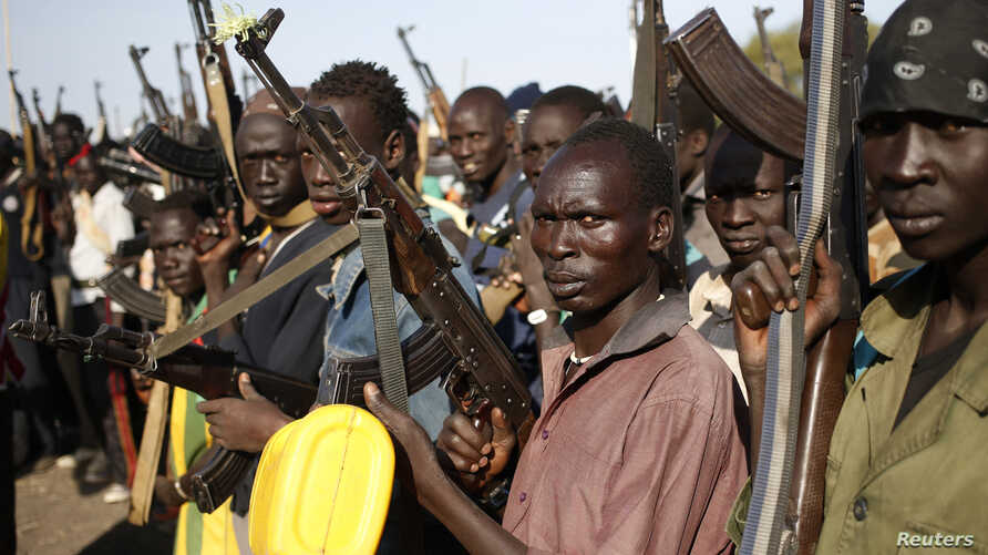 FILE - Jikany Nuer White Army fighters hold their weapons in Upper Nile State, February 2014.
