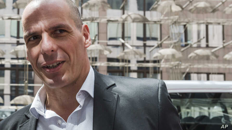 Greek Finance Minister Yanis Varoufakis arrives for a meeting of the eurogroup finance ministers at the EU Council building in Brussels May 11, 2015.