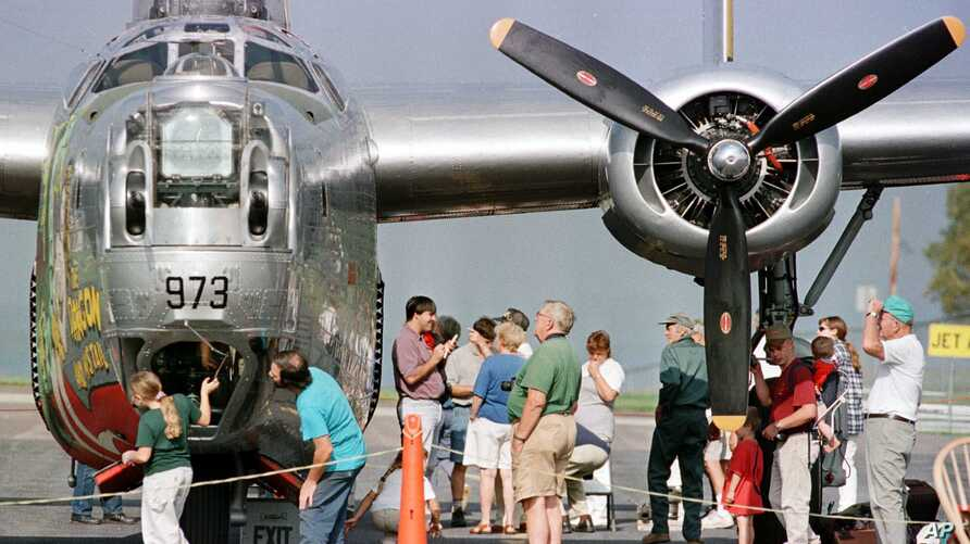 "Spectators look at a B-24 Liberator, World War II bomber  ""The Dragon and His Tail"" at the Knapp Airport in Berlin, Vermont."
