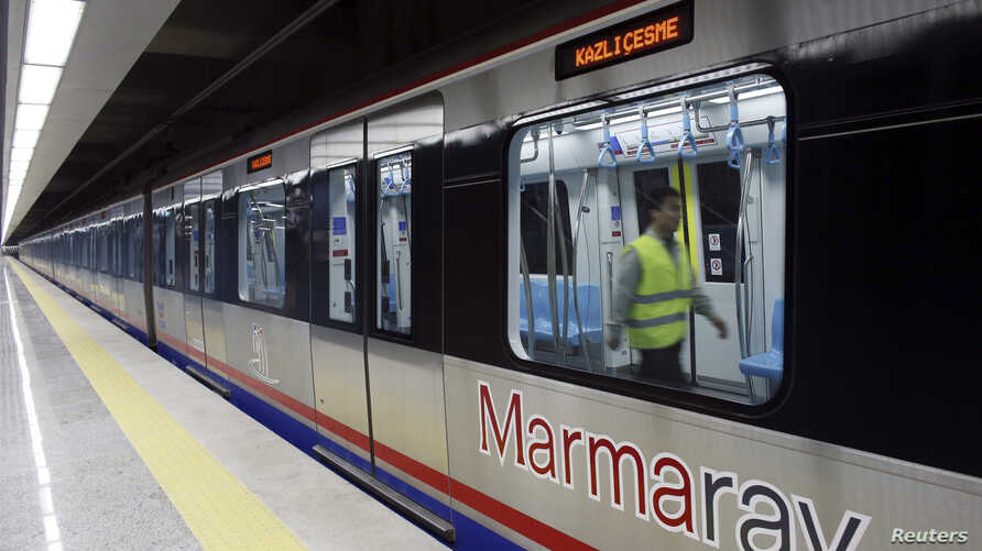 An engineer performs a last check on a train that will travel through Marmaray tunnel, a subway that links Europe with Asia some 60 meters below the Bosphorus Strait, in Istanbul, Oct. 29, 2013.
