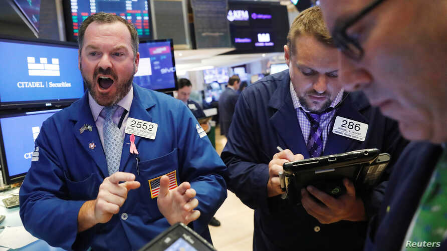 Traders work on the floor of the New York Stock Exchange shortly after the opening bell in New York, U.S., July 23, 2018.