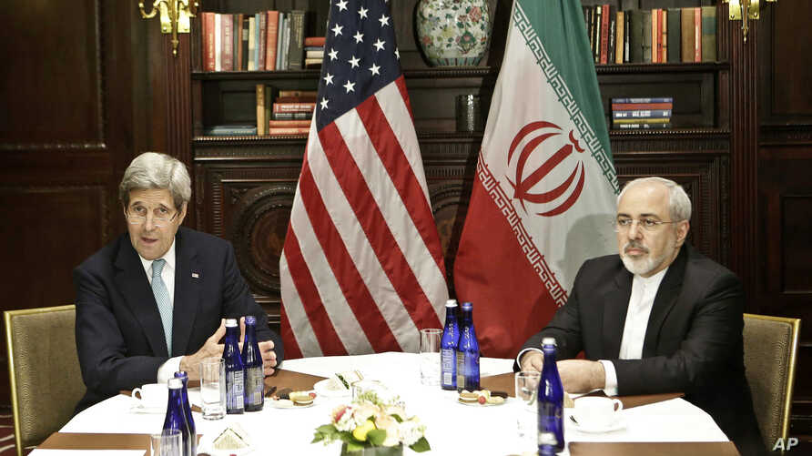 FILE - U.S. Secretary of State John Kerry, left, speaks to the media as he meets with Iranian Foreign Minister Mohammad Javad Zarif.