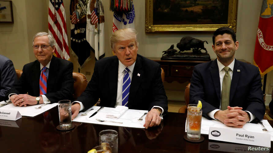 President Donald Trump hosts a lunch with Senate Majority Leader Mitch McConnell (L) and Speaker of the House Paul Ryan (R) at the White House in Washington, March 1, 2017.