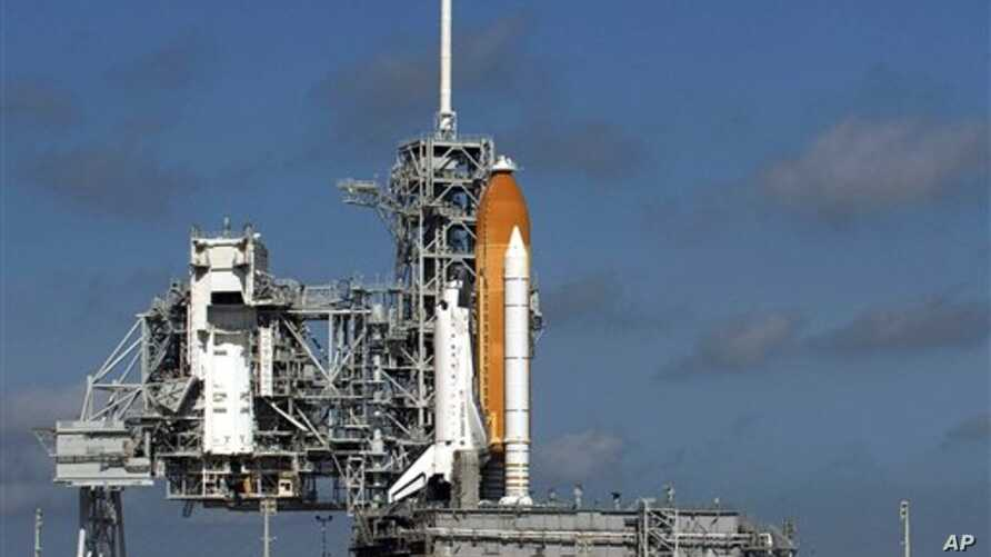 Space Shuttle Discovery sits on its launch pad in Cape Canaveral, Florida, 24 Oct 2010