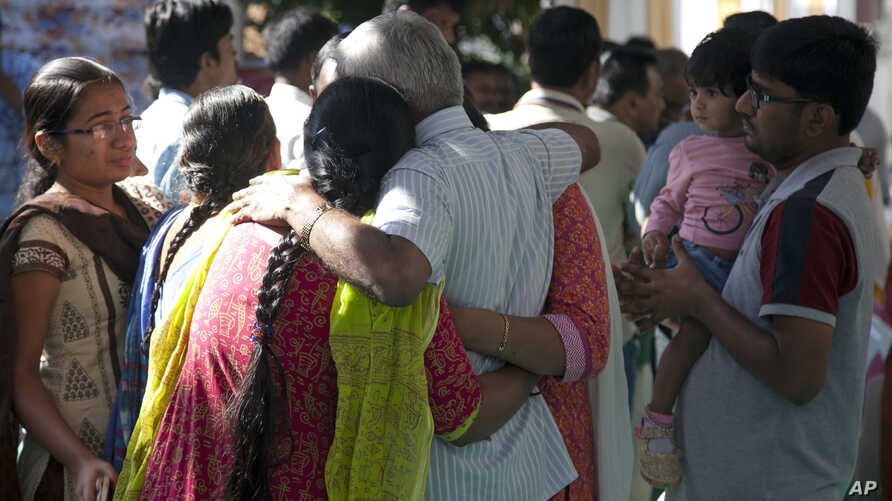 Relatives grieve as last rites are performed on Srinivas Kuchibhotla, a 32-year-old engineer who was killed in an apparently racially motivated shooting in a crowded Kansas bar, at his residence in Hyderabad, India, Tuesday, Feb.28, 2017.