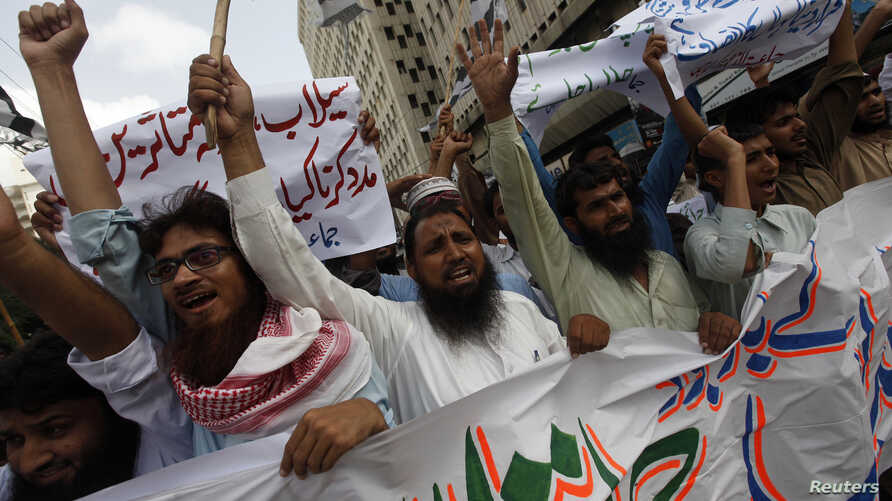 FILE - Supporters of the Jamaat-ud-Dawa organisation chant slogans during a protest rally in Karachi, June 27, 2014.