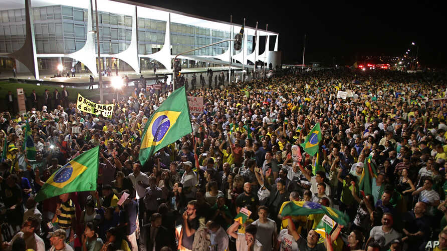 Demonstrators call for the impeachment of Brazil's President Dilma Rousseff and protest the naming of her mentor, former President Luiz Inacio Lula da Silva, as her new chief of staff, outside Planalto presidential palace in Brasilia, Brazil, Wednesd
