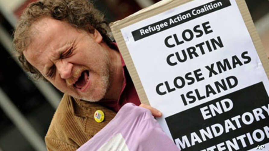 """An activist from the """"Refugee Action Coalition"""" yells out during a rally in Sydney in support of refugees (2010 File)"""