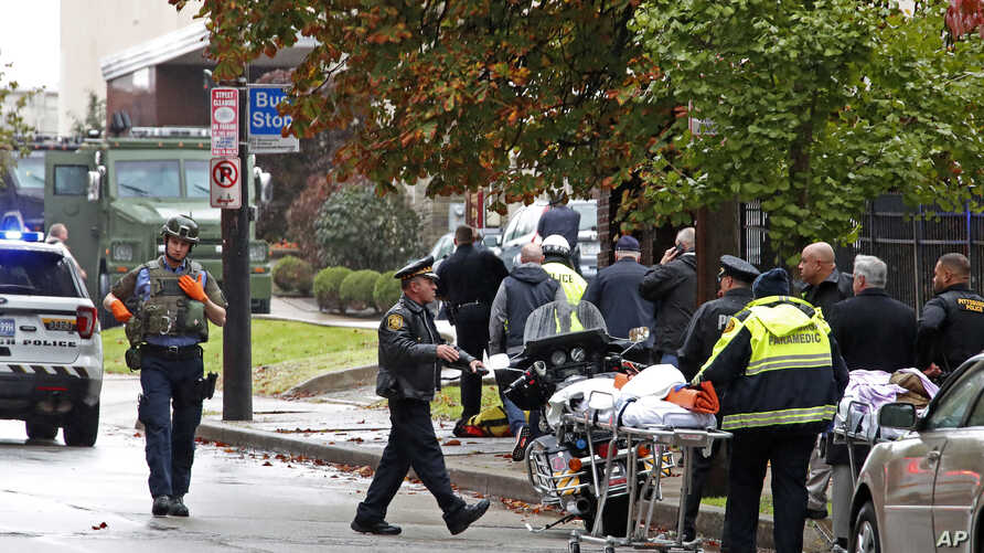 First responders are seen at the Tree of Life Synagogue where a shooter opened fire, In Pittsburgh, Pennsylvania, Oct. 27, 2018, causing multiple casualties.