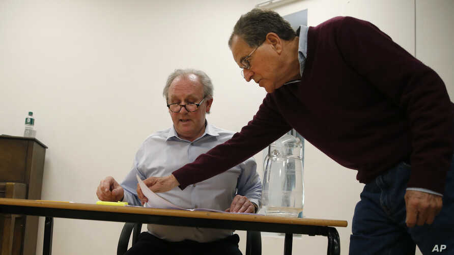 """Theater director Nicholas Kent, right, and actor Peter Davison rehearse for the play """"All the President's Men?"""" in London, April 20, 2017. Davison will play U.S. Secretary of State Rex Tillerson."""