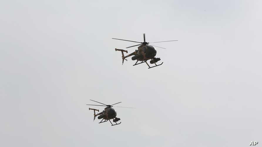 FILE - U.S.-made MD-530 helicopters, as the ones used by the Afghan Air Force, fly over Kabul, Afghanistan, Feb. 11, 2016.