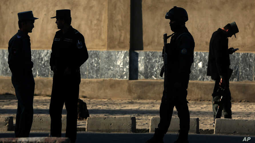Afghan National police soldiers stand near the Defense Ministry compound in Kabul, Afghanistan, Feb. 27, 2016.