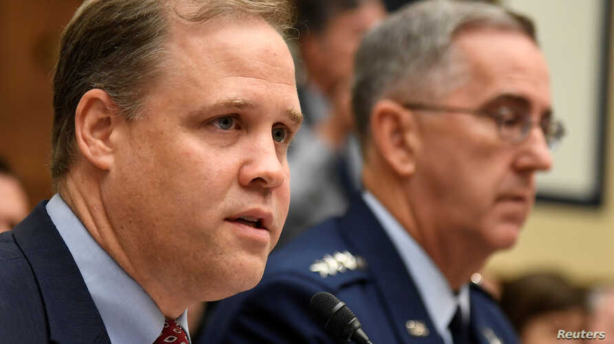 FILE - NASA Administrator Jim Bridenstine (L) makes remarks as U.S. Strategic Command Commander Gen. John Hyten listens during the House Armed Services Strategic Forces Subcommittee's joint hearing with the House Science, Space and Technology Committ