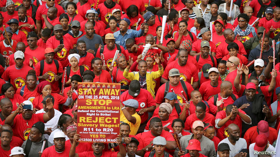 FILE - South African union members march during a nationwide protest against a proposed minimum wage in Cape Town, South Africa, April 25, 2018.