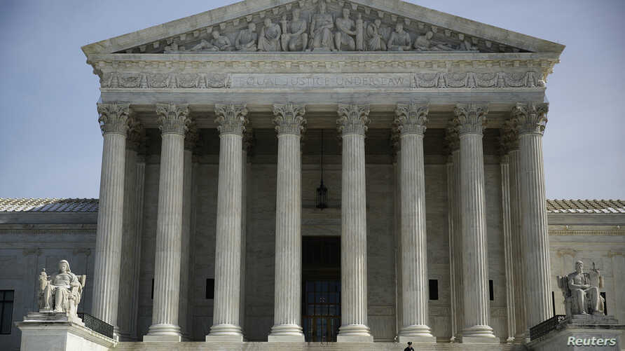 The exterior of the U.S. Supreme Court is seen in Washington March 5, 2014. U.S. Supreme Court justices on Wednesday appeared to look for a compromise that would enable them to avoid overruling a 26-year-old precedent that made it easier for plaintif