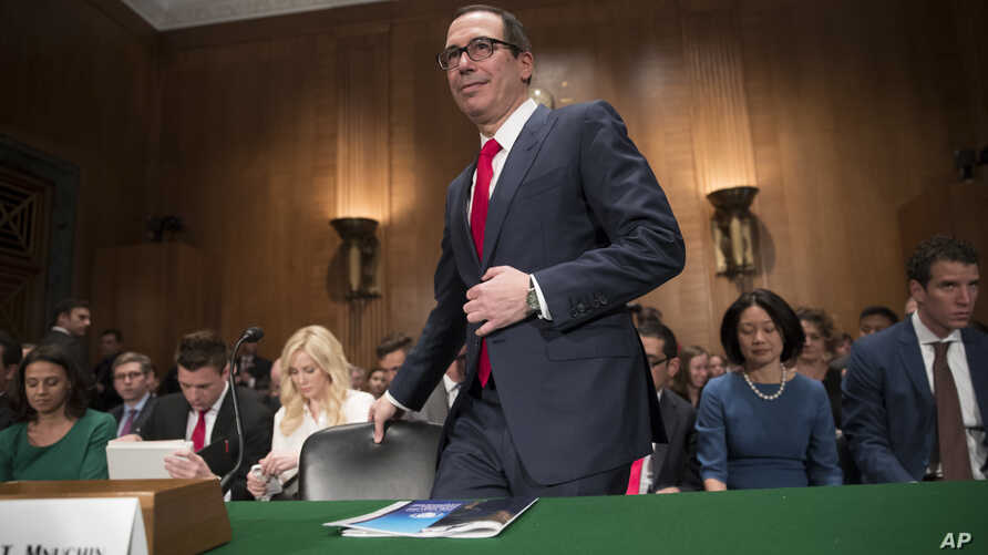 Treasury Secretary Steven Mnuchin arrives on Capitol Hill in Washington, May 18, 2017, to testify before the Senate Banking Committee hearing on tax policy.
