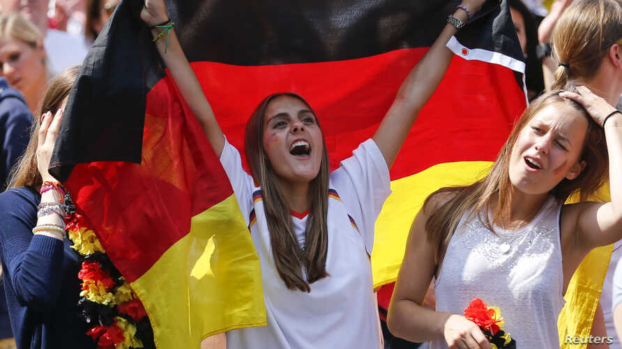 Soccer fans cheer the German national soccer team during celebrations to mark the team's 2014 Brazil World Cup victory, at a 'fan mile' public viewing zone in Berlin July 15, 2014. Germany's victorious soccer team led by coach Joachim Loew returned h...