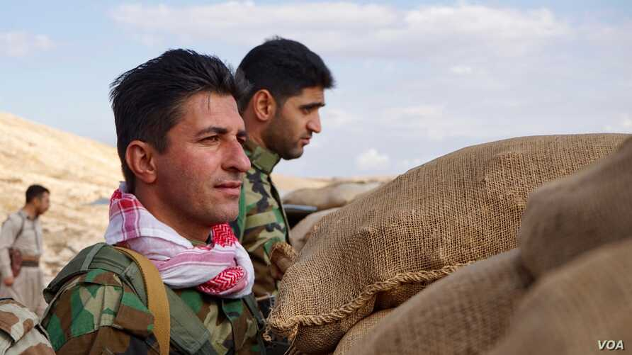 Iranian Kurdish fighters stand watch on the Bashiqa front lines, Nov. 2, 2016. Last week, there were high Kurdish casualties during an offensive on the Islamic State-held town 30 kilometers from Mosul. (J. Dettmer/VOA)
