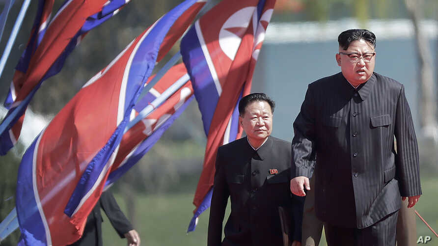 North Korean leader Kim Jong Un, right, and Choe Ryong Hae, vice-chairman of the central committee of the Workers' Party, arrive for the official opening of the Ryomyong residential area, April 13, 2017, in Pyongyang, North Korea.