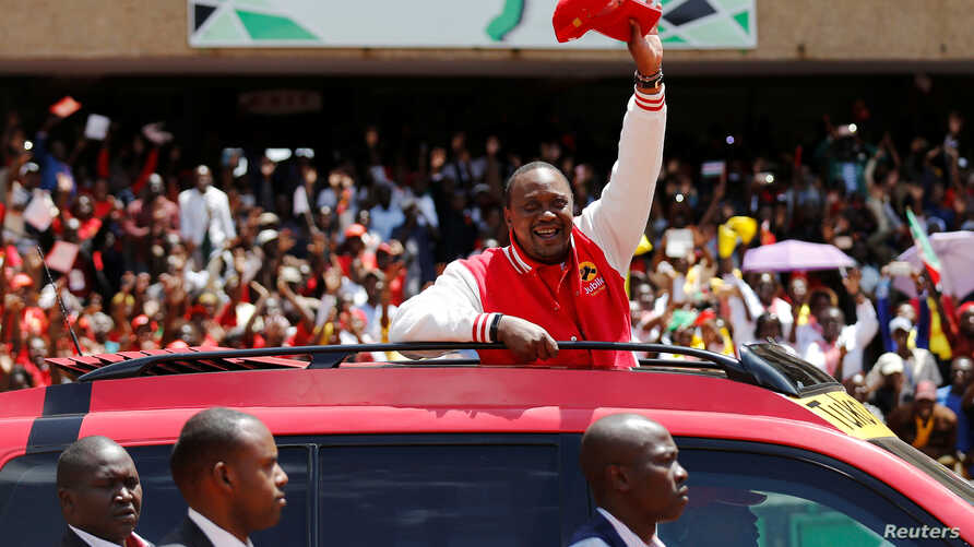 Kenya's President Uhuru Kenyatta waves to supporters as he arrives at the Kasarani stadium for the official launch of the Jubilee Party ahead of the 2017 general elections in Kenya's capital Nairobi, Sept. 10, 2016.