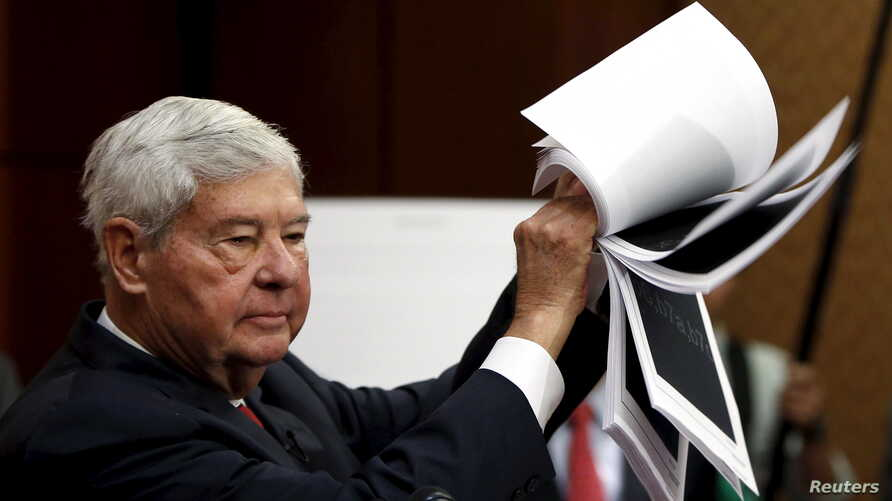 """Former Senator Bob Graham (D-FL) displays 28 pages that are still classified, and blacked out, of a U.S. government report on who financed the 9/11 attacks on the United States, at a news conference on Capitol Hill in Washington to unveil """"The Transp"""