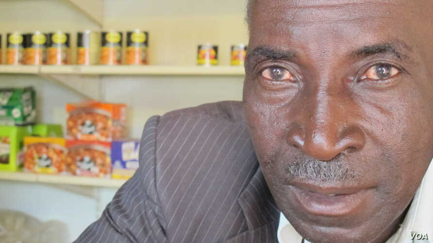 John Stheole has owned his spaza shop for more than a decade in Dube Village, Soweto, South Africa. (Photo Gillian Parker for VOA)