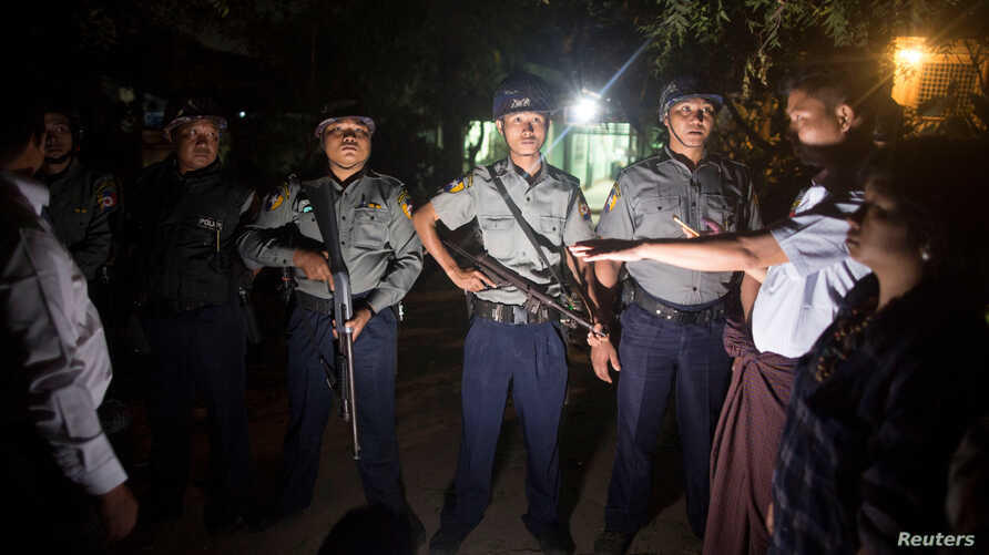 Myanmar Police stand guard at the forensic department of a hospital where the body of Ko Ni is kept, a prominent member of Myanmar's Muslim minority and legal adviser for Myanmar's ruling National League for Democracy, in Yangon, Jan.  29, 2017.