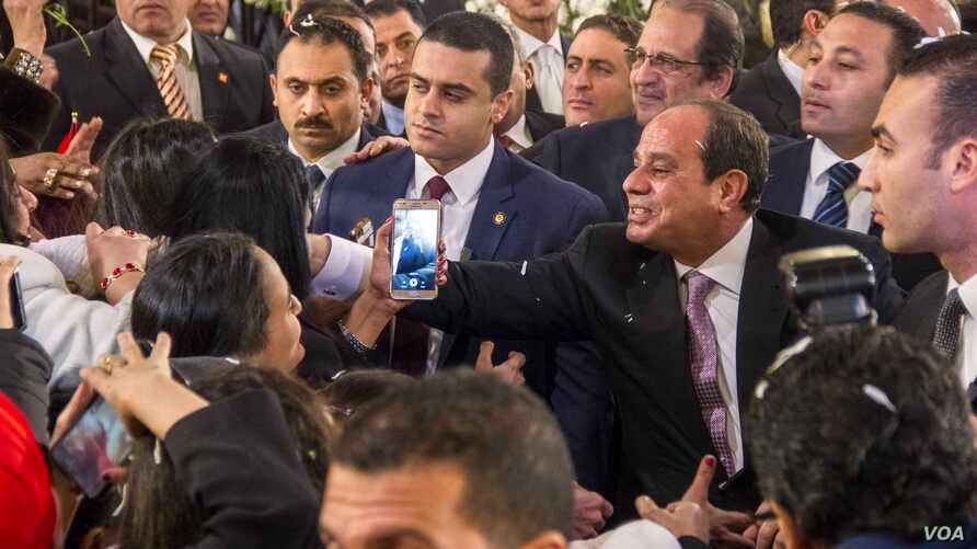 Egyptian President Abdulfattah Al-Sisi greets Coptic women at entrance of new Coptic Cathedral in Egypt, Jan 6, 2018. (Photo: Hamada Elrasam for VOA)