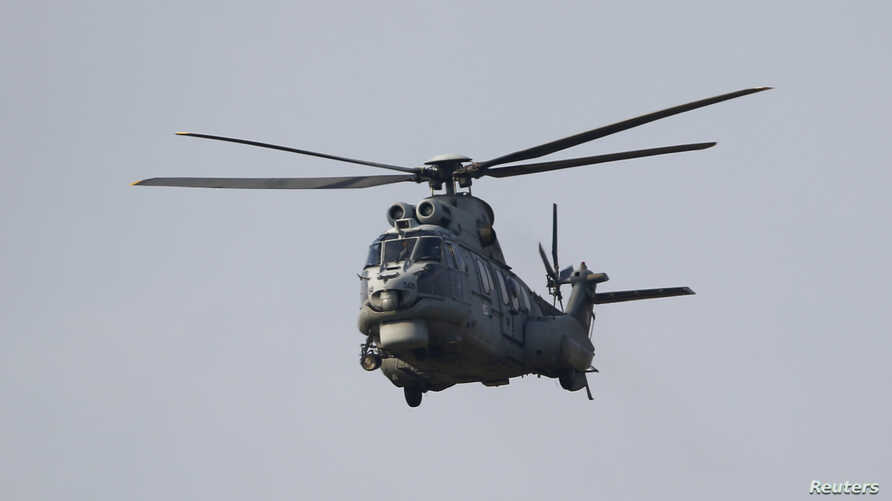 A Turkish Air Force AS-532AL Cougar helicopter takes off from Incirlik airbase in the southern city of Adana, Turkey, July 27, 2015. Kurdish fighters in northern Syria accused the Turkish army of shelling their positions on Monday.