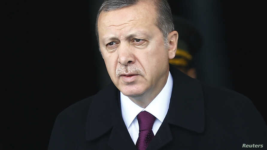 FILE - Turkey's President Tayyip Erdogan arrives for a welcoming ceremony at the Presidential Palace in Ankara, March 3, 2015.