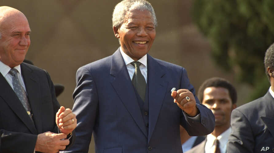 President Nelson Mandela dances at a celebration concert following his inauguration at the Union Buildings in Pretoria, South Africa, May 10, 1994.