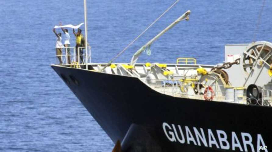 Suspected pirates indicate their surrender with a white cloth on the bow of the Japanese-owned commercial oil tanker MV Guanabara in the Arabian Sea (File Photo -March 6, 2011)