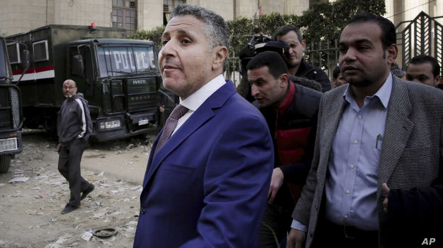 Egyptian lawyer Negad al-Borai, center left, leaves the high court after a hearing, in Cairo, Egypt. Al-Borai said Wednesday, Jan. 30, 2019 that Egypt has rounded up at least six activists in the last couple of days in a wave of arrests coinciding wi