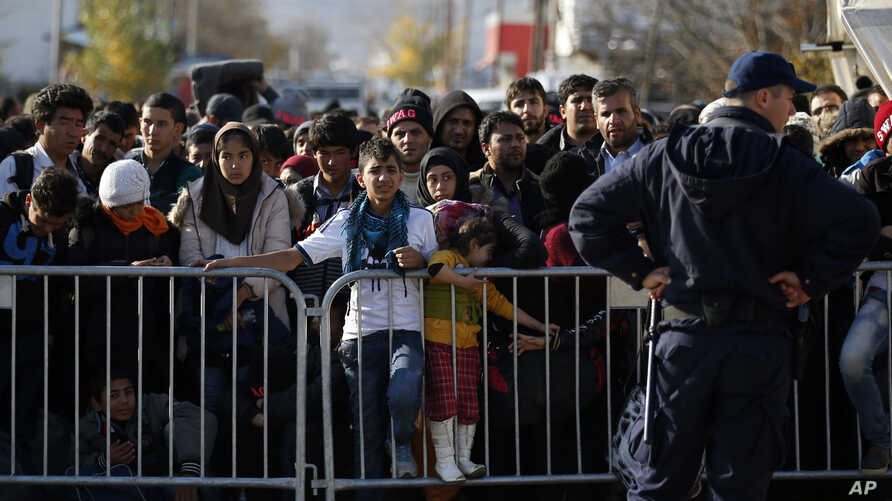 Migrants wait to register with police at a refugee center in the southern Serbian town of Presevo, Nov. 16, 2015.