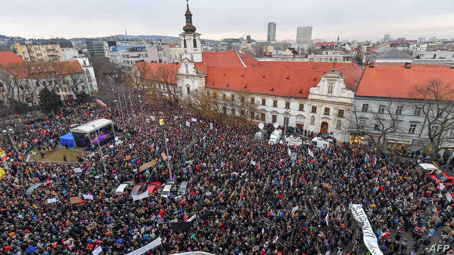 "People gather at Slovak National Uprising (SNP) square during a rally under the slogan ""For a Decent Slovakia"", against corruption and to pay tribute to murdered Slovak journalist Jan Kuciak and his fiancee Martina Kusnirova on March 9, 2018 in Brati"