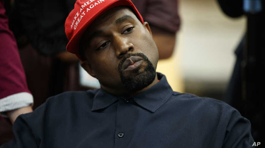 Rapper Kanye West listens to a question from a reporter during a meeting in the Oval Office of the White House with President Donald Trump, Oct. 11, 2018, in Washington.