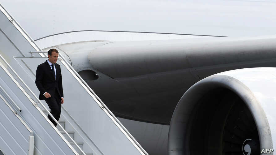 FILE - French President Emmanuel Macron arrives at the Felix Eboue airport in Cayenne, Guiana, Oct. 26, 2017. Macron heads to Africa Monday on a three-nation tour.