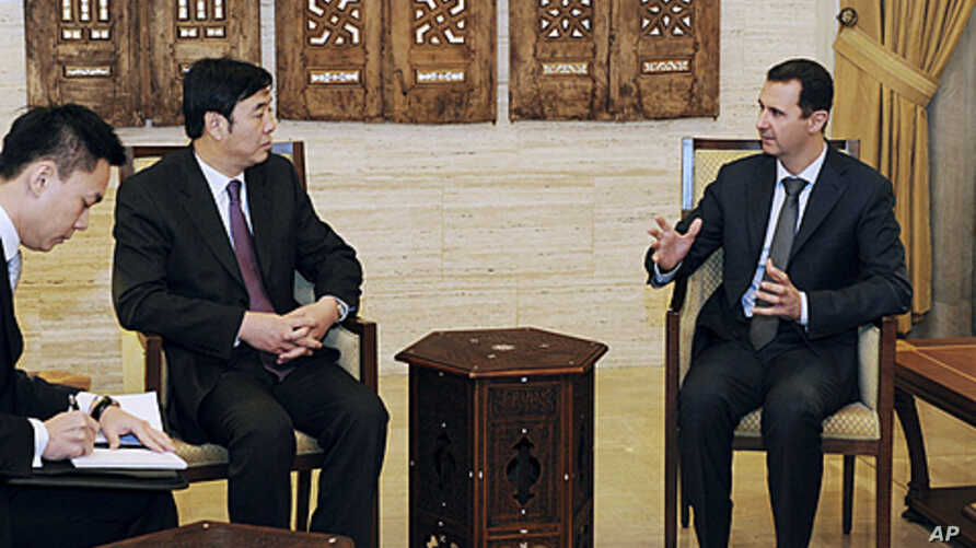 Syria's President Bashar al-Assad (R) meets Chinese Vice Foreign Minister Zhai Jun in Damascus, February 18, 2012.