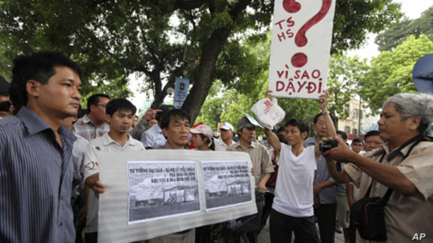 Protesters hold anti-China placards while marching near the Chinese embassy in Hanoi July 10, 2011