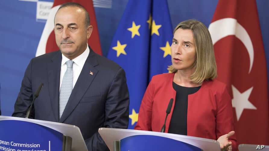 Turkey's Foreign Minister Mevlut Cavusoglu, left, and High Representative of the European Union for Foreign Affairs and Security Policy Federica Mogherini, speak at a press conference in Brussels, July 25, 2017.