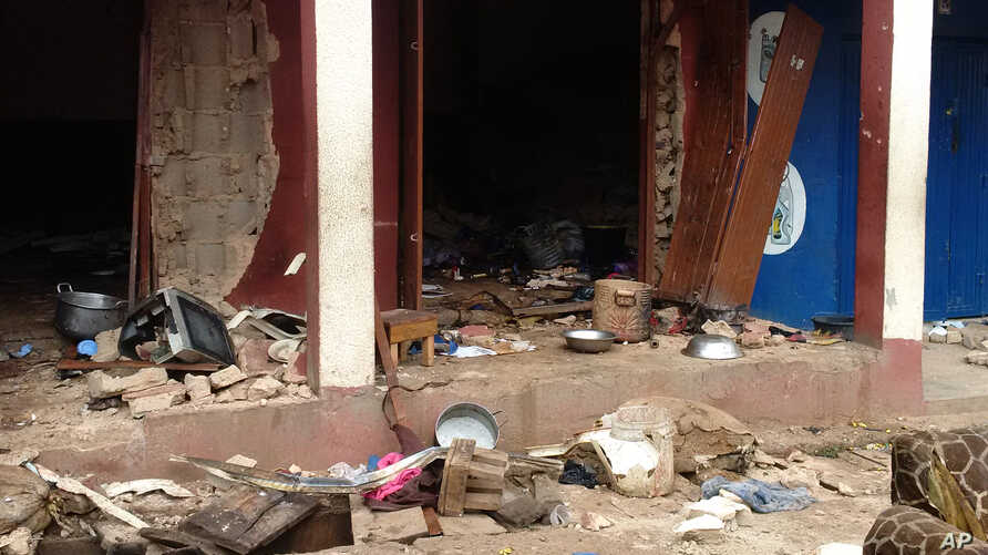 In this photo taken on a mobile phone, debris is strewn after a bomb exploded at a mosque in Jos, Nigeria, July 6, 2015.