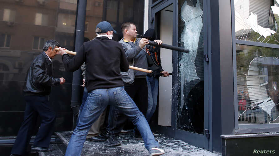 Pro-Russia protesters storm the governor's business premises in Donetsk, eastern Ukraine, May 3, 2014.