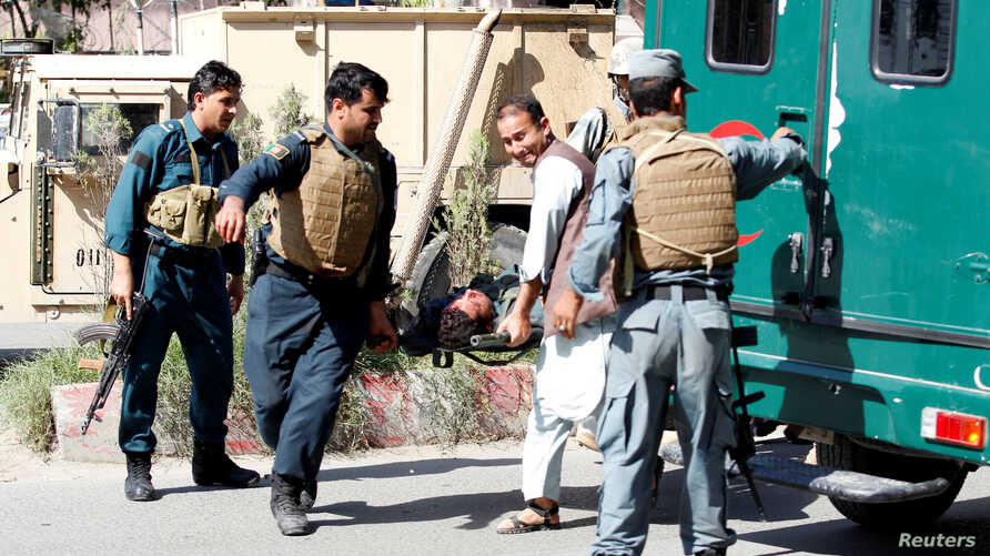 Afghan policemen transport the body of a police after gunmen attack in Jalalabad city eastern Afghanistan, May 17, 2017.