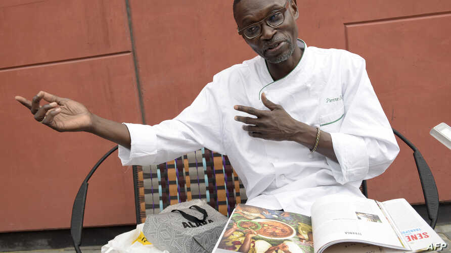 FILE - Senegalese pioneer of African cuisine Pierre Thiam speaks about his book on African cuisine at Nok By Alara, a restaurant in Victoria Island district of Lagos, Jan. 14, 2016.