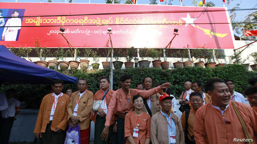 Congress delegates prepare to pose for photographs as they arrive to attend the National League for Democracy party's (NLD) congress in Rangoon, March 8, 2013.