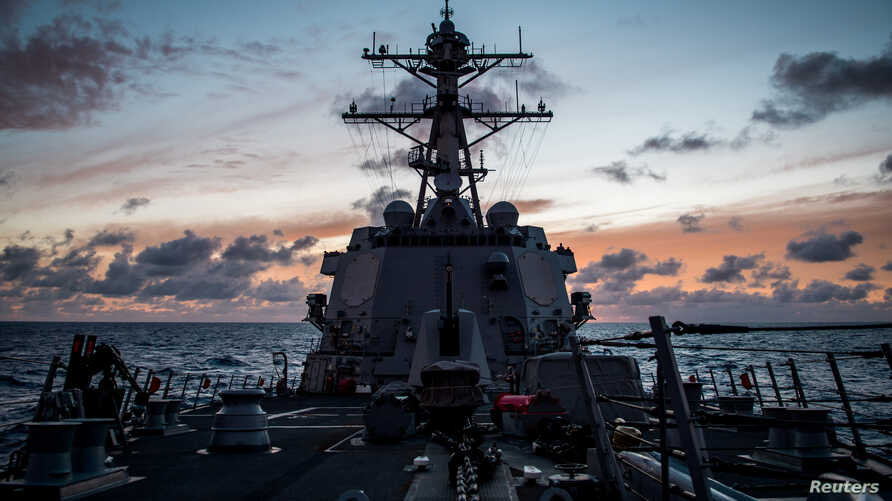 The guided-missile destroyer USS Dewey transits the Pacific Ocean while participating in Rim of the Pacific Exercise (RIMPAC),  July 10, 2018.