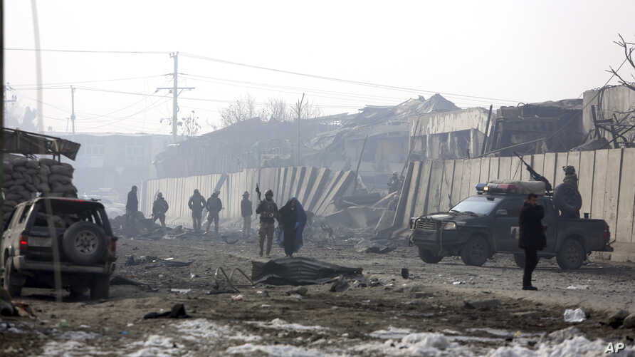 Afghan security forces gather at the site a day after an attack in Kabul, Afghanistan, Tuesday, Jan. 15, 2019.
