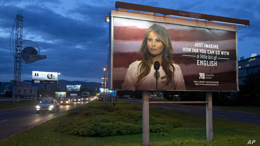 Cars drive past a billboard depicting U.S. first lady Melania Trump and advertising a language school, in Zagreb, Croatia, Sept. 15, 2017.
