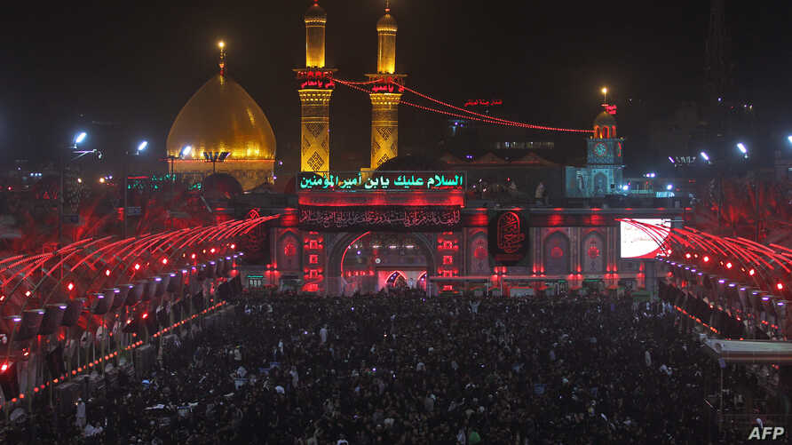 Shiite pilgrims take part in a ceremony at the Imam Hussein shrine in the southern Iraqi city of Karbala, Sept. 19, 2018, on the eve of the 10th day of the mourning period of Muharram, which marks the peak of Ashura. Ashura commemorates the death of